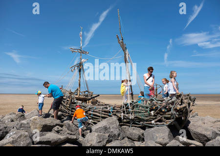 Children on Pirate Ship made of Driftwood Playing - Stock Photo