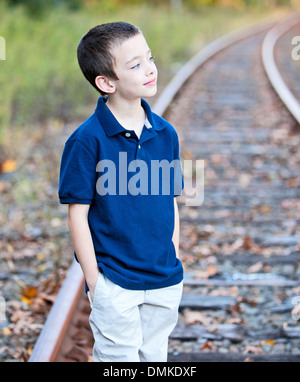 Young boy looking off to the side outdoor portrait - Stock Photo