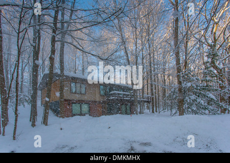 House in early morning on a blue sky sunny winter day in Western New York State - Stock Photo