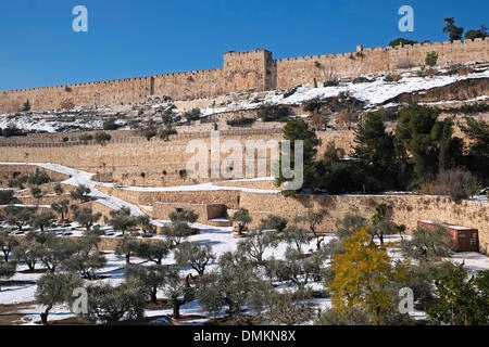 Snow blankets the Kidron Valley or Wadi an-Nar and the Golden Gate or Bab al-Dhahabi in Arabic at the eastern walls - Stock Photo
