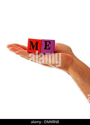 Closeup of a hand holding the word Me in baby blocks, possibly for a business or personal health strategy. - Stock Photo