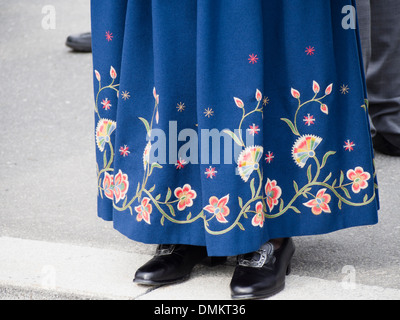 17th may Norwegian constitution day, detail of womens costume, skirt with traditional floral embroidery - Stock Photo