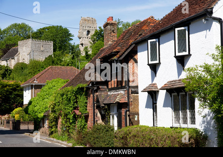 Village of Bramber, West Sussex, England, UK. Main street with St Nicholas Church (Norman) and remains of Norman - Stock Photo