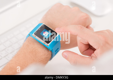 Male finger tap on the icon of unread messages on the smart watch - Stock Photo
