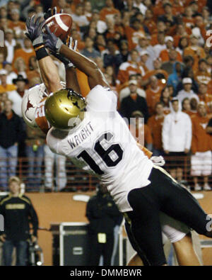 10 OCT 2009: Texas safety Blake Gideon picks off a Cody Hawkins pass to Anthony Wright at the Texas 15 yard line. - Stock Photo
