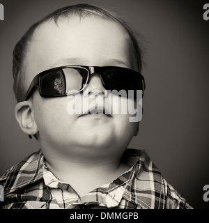 Portrait of a toddler, wearing sunglasses - Stock Photo