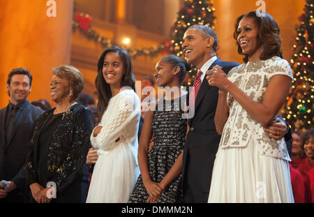 Washington DC, USA. 15th Dec, 2013. United States President Barack Obama (2nd R) and first lady Michelle Obama (R), - Stock Photo