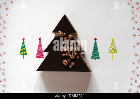 Marks & Spencer Christmas Tree dessert on festive plate with Christmas trees on - Stock Photo