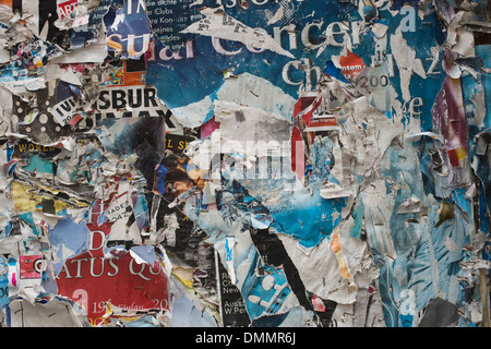 Germany, Bavaria, Regensburg, torn posters on wall - Stock Photo