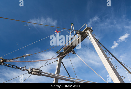 Blue mediterranean fishing boat with rod and reels stock for Fishing rod in spanish