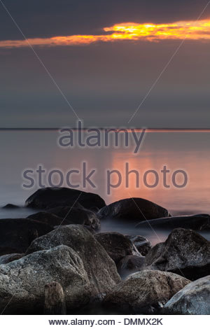 Germany, Baltic Sea, Bay of Luebeck, stones in the evening - Stock Photo