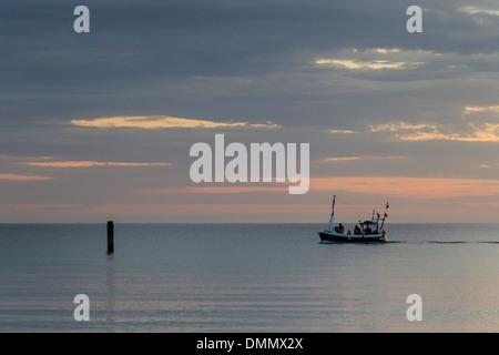 Germany, Baltic Sea, Bay of Luebeck, fishing boat in the morning - Stock Photo