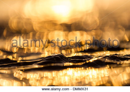 Germany, Baltic Sea, Bay of Luebeck, wave during sunrise - Stock Photo
