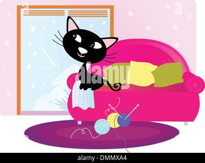 Christmas: Black Cat sitting on sofa and looking through window - Stock Photo