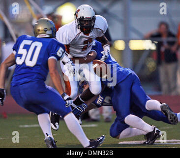 SPORTS   A fumble stops Madison's scoring threat early in the game. Madison plays Kerrville Tivy at Kerrville on - Stock Photo