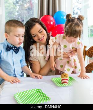 Family Celebrating Girl's Birthday - Stock Photo
