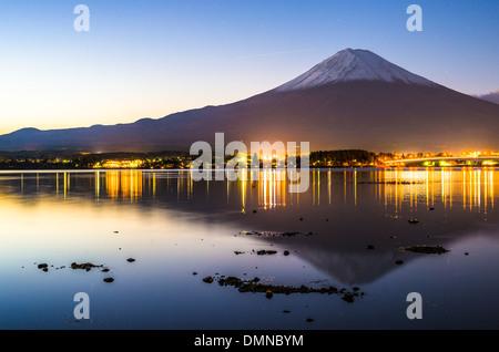 Mt. Fuji at dusk over Lake Kawaguchi in Japan. Stock Photo