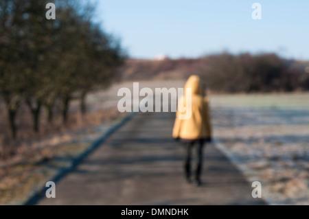 Woman walks along a path