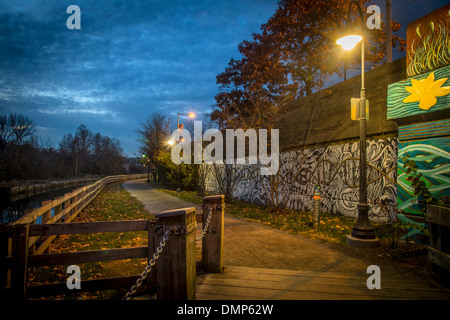 Walkway Lit By Lamp At Night - Stock Photo