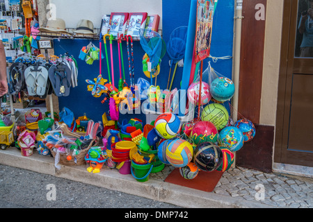 Everything for the beach including Buckets and spades, footballs, beach balls, Flip Flops, Fishing nets, Windmills, - Stock Photo