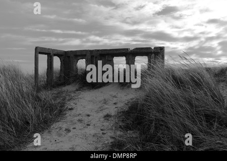 WW2 Concrete Pillbox ruins on sand dunes at Winterton-on-sea, Norfolk, England - Stock Photo