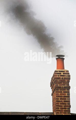 Smoking Chimney - domestic chimney smoking - Stock Photo