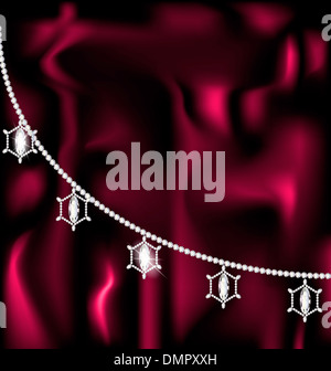 on a red-purple silk there is a jewelry necklace - Stock Photo