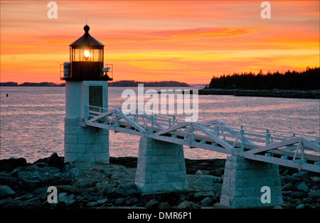 Sunset over Marshall Point lighthouse, in Port Clyde, Maine. - Stock Photo
