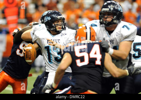 Maine quarterback Warren Smith looks to pass as the pocket collapses in the second half of Saturday's 41-24 Syracuse - Stock Photo