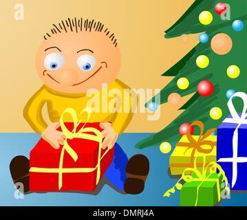 Child unpacking a present - Stock Photo