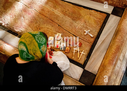 The Stone of Anointing, also known as The Stone of Unction inside the Church of the Holy Sepulchre. - Stock Photo