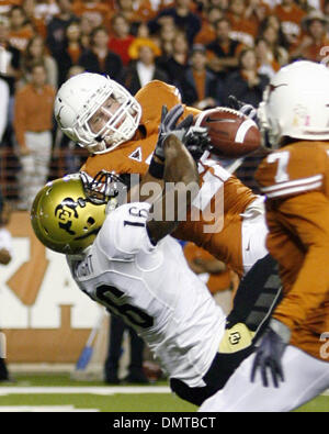 Texas safety Blake Gideon picks off a Cody Hawkins pass at the Texas 15 yard line that was intended for Anthony - Stock Photo