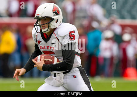 Ball State Cardinals quarterback Kelly Page (5) scrambling with the ball during the NCAA football game between the - Stock Photo