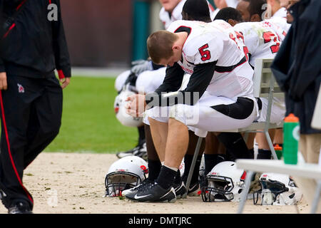 Ball State Cardinals quarterback Kelly Page (5) hangs his head on the bench during the NCAA football game between - Stock Photo