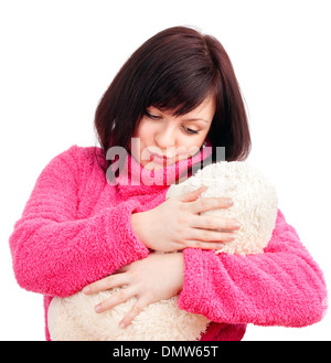 Young Woman in Pink Bathrobe Cuddling with her Teddy Bear - Stock Photo