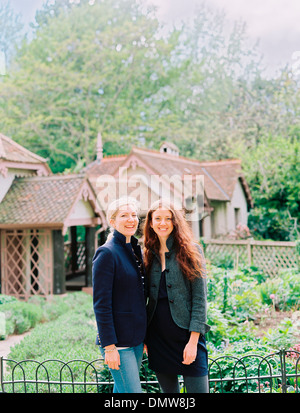 Two women  in a garden of a historic house. - Stock Photo