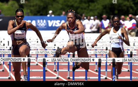 Jun 23, 2002; Palo Alto, CA, USA; Gail Dever clears the final hurdle in the 100 meter hurdle final at the USA Track - Stock Photo