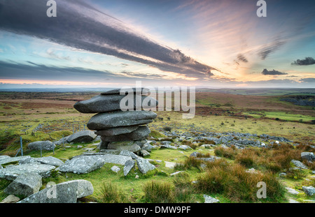 Sunset at the Cheesewring on Bodmin Moor in Cornwall, a weathered natural rock formation made up of precariously - Stock Photo