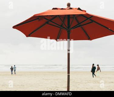 A large beach umbrella on  beach at Manzanita on  Pacific Ocean in Oregon. - Stock Photo