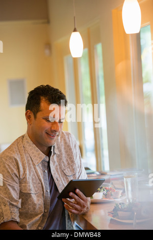 A man using a digital tablet. - Stock Photo
