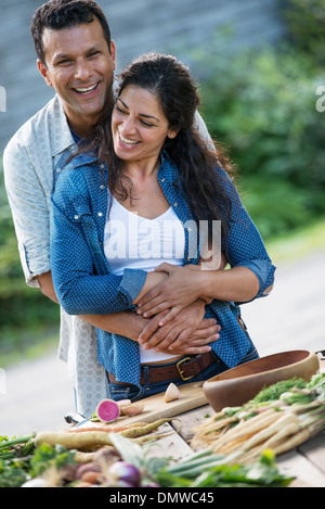 A man and woman toger outdoors in summer. - Stock Photo