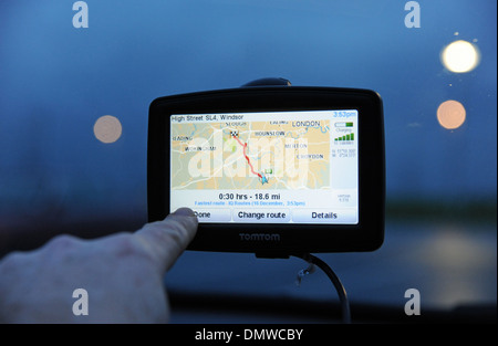 TomTom Sat nav being used in a car for navigation - Stock Photo