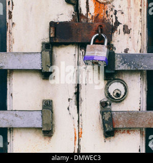 Close up of a padlocked and bolted door. - Stock Photo