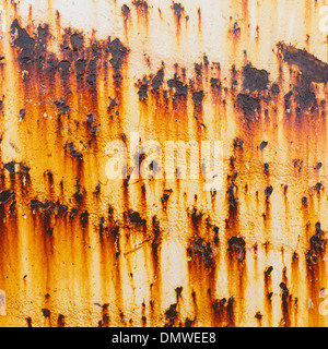 Streaks of rust from steel bolts on a metal sheet.l - Stock Photo