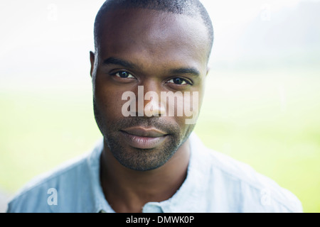 A young man in a blue shirt. - Stock Photo