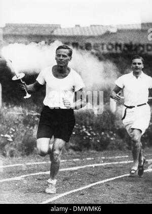 May 10, 1936 - Berlin, Germany - Athletes carrying the torch at the Opening ceremony of the Olympics in Berlin. - Stock Photo
