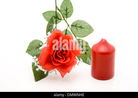 Rose with wax candle - Stock Photo