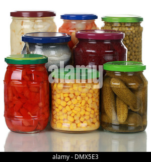 Preserved vegetables in glass jars, isolated on white - Stock Photo