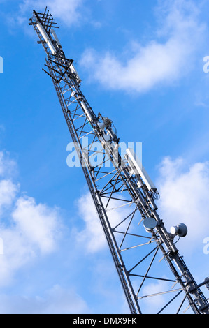 communications tower and cell phone antenna mast - Stock Photo