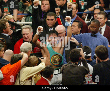Jan 21, 2006; Las Vegas, NV, USA; MANNY PACQUIAO of the Philippines, celebrates after stopping Erik Morales in the 10th round to win the super featherweight boxing match Saturday night. Mandatory Credit: Photo by J.P. Yim/ZUMA Press. (©) Copyright 2006 by J. P. Yim